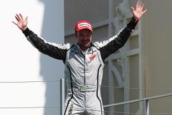 Podium: race winner Rubens Barrichello, BrawnGP celebrates