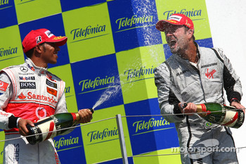 Podium: champagne celebration for race winner Rubens Barrichello, BrawnGP, second place Lewis Hamilton, McLaren Mercedes