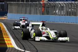 Jenson Button, BrawnGP, Robert Kubica, BMW Sauber F1 Team