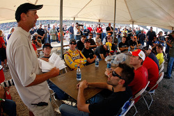 Drivers sit and listen during the driver's meeting