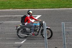Sebastian Vettel, Ferrari on a Triumph motorbike