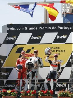 Podium: race winner Jorge Lorenzo, Fiat Yamaha Team celebrates with second place Casey Stoner, Ducati Marlboro Team, third place Dani Pedrosa, Repsol Honda Team