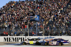 Brad Keselowski takes the checkered flag in front of Kyle Busch