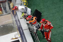 Podium: race winner Casey Stoner, Ducati Marlboro Team with second place Dani Pedrosa, Repsol Honda Team, third place and 2009 MotoGP champion Valentino Rossi, Fiat Yamaha Team