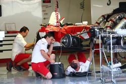 Toyota Mechanics working on their car
