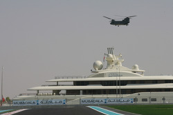 A helicopter comes to land at the circuit