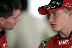 Sebastian Hohenthal talks with a mechanic