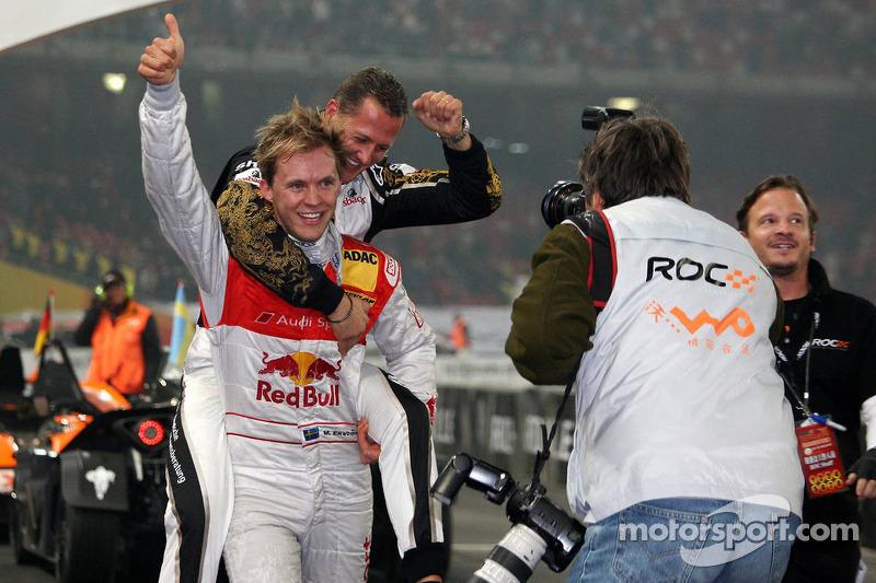 Race of Champions winner Mattias Ekström celebrates with Michael Schumacher
