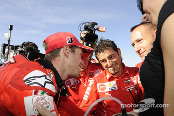 Pole winner Casey Stoner, Ducati Marlboro Team celebrates