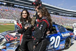 Joey Logano and the Bella twins from the WWE