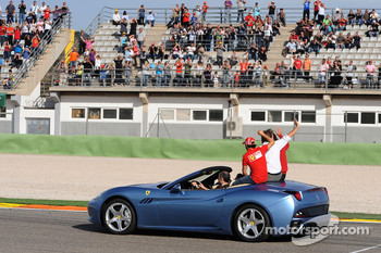 A backup Ferrari California picks up Luca di Montezemolo, Felipe Massa and Fernando Alonso for the drive around the track