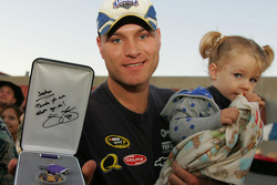 Joshua Deering and his daughter Kaydence show his Purple Heart signed by Jimmie Johnson, four-time NASCAR Sprint Cup Champion, at Camp Pendelton in Oceanside, California