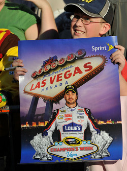 Top 12 victory lap parade: a young Jimmie Johnson fan holds up a poster