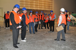 Media, clad in hard hats and orange vests, visit construction site of new Hall of Fame