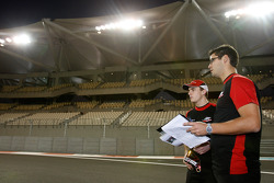 Jules Bianchi talks with his engineer during a track walk