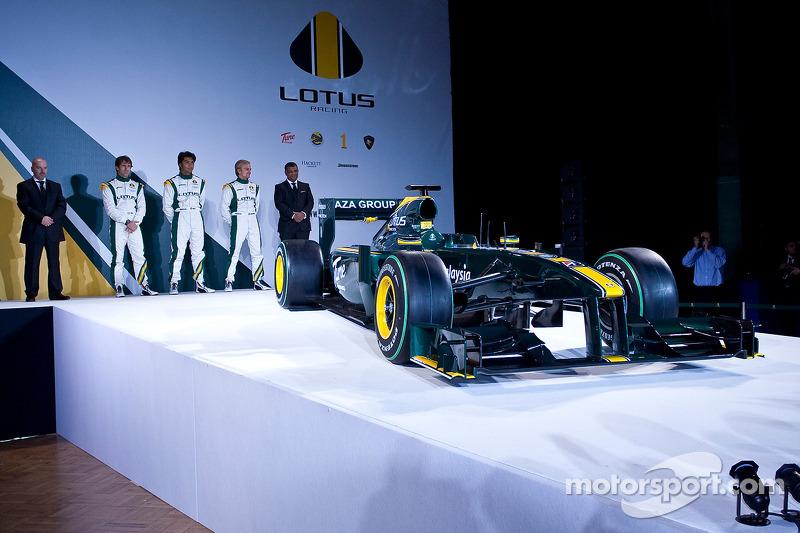 2010 Lotus F1 car with senior team members