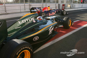 Jarno Trulli, Lotus F1 Team and Sebastian Vettel, Red Bull Racing