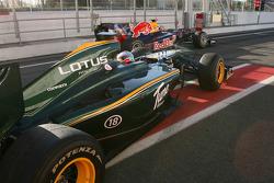 Jarno Trulli, Lotus F1 Team and Sebastian Vettel, Red Bull Racing