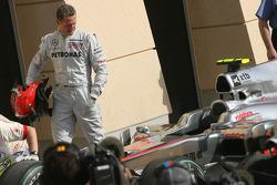 Michael Schumacher, Mercedes GP, looks at the Mclaren