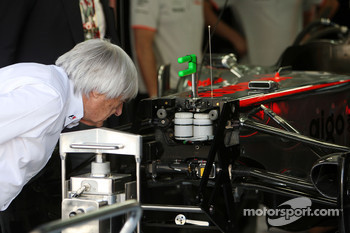 Bernie Ecclestone takes a close look at the McLaren Mercedes