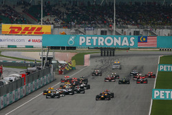 Sebastian Vettel, Red Bull Racing and Mark Webber, Red Bull Racing lead the start of the race