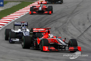 Timo Glock, Virgin Racing leads Rubens Barrichello, Williams F1 Team