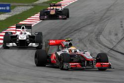 Lewis Hamilton, McLaren Mercedes leads Kamui Kobayashi, BMW Sauber F1 Team