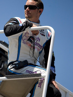 Casey Mears, Denny Hamlin's potential replacement driver, sits on top of the hauler during practice