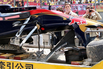 The damaged car of Sebastien Buemi, Scuderia Toro Rosso is returned to the pits