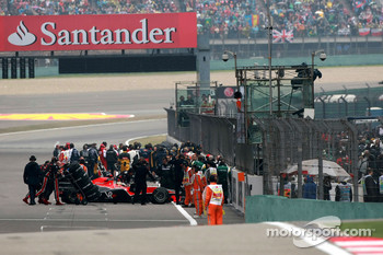 Timo Glock, Virgin Racing, has problems on the grid