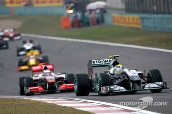Nico Rosberg, Mercedes GP leads Jenson Button, McLaren Mercedes