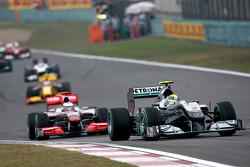 Nico Rosberg, Mercedes GP leads Jenson Button, McLaren Mercedes