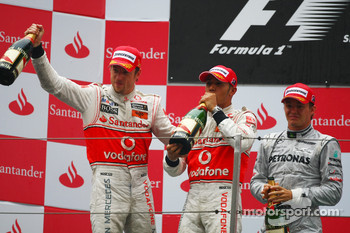 Podium: race winner Jenson Button, McLaren Mercedes, with second place Lewis Hamilton, McLaren Mercedes, and third place Nico Rosberg, Mercedes GP Petronas