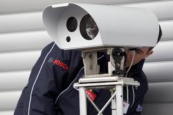 Team Peugeot Total team member prepares pit equipment