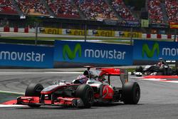 Jenson Button, McLaren Mercedes leads Michael Schumacher, Mercedes GP Petronas