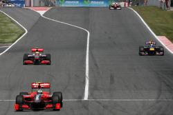 Lucas di Grassi, Virgin Racing, Sebastian Vettel, Red Bull Racing and Lewis Hamilton, McLaren Mercedes goes out of the pits
