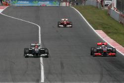 Michael Schumacher, Mercedes GP  Jenson Button, McLaren Mercedes