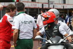 Rob Smedly, Scuderia Ferrari, Chief Engineer of Felipe Massa, Michael Schumacher, Mercedes GP rides around the circuit with Andrew Shovlin, Mercedes GP, Senior Race Engineer to Michael Schumacher