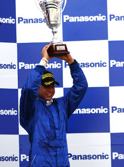 Felipe Guimaraes celebrates on the podium
