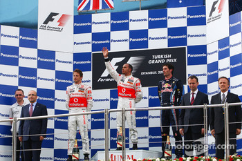 Podium: race winner Lewis Hamilton, McLaren Mercedes, second place Jenson Button, McLaren Mercedes, third place Mark Webber, Red Bull Racing