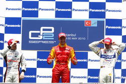 Dani Clos celebrates his victory on the podium with Luiz Razia and Giedo Van der Garde
