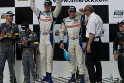 GT podium: winners #68 SpeedSource Mazda RX-8: Adam Christodoulou, John Edwards