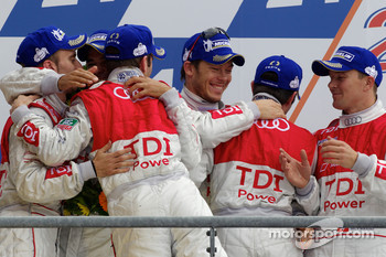Race winners Romain Dumas, Mike Rockenfeller and Timo Bernhard celebrate on the podium