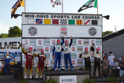 DP podium: class and overall winners Scott Pruett and Memo Rojas, second place Oswaldo Negri and John Pew, third place Burt Frisselle and Mark Wilkins