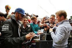 Lewis Hamilton, Mercedes AMG F1 and team mate Nico Rosberg, Mercedes AMG F1 sign autographs for the fans