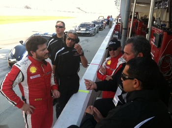 Carlos, Rudy, John, Ryan and Travis confer on pit lane.