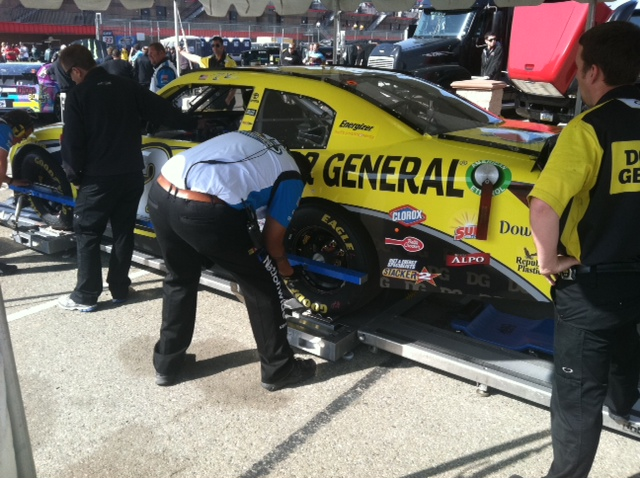 tech template station #4 - Brian Vickers' car gets its wheelbase checked.