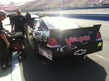 Tony Clements & Tommy Blackwell monitor the #51 Jeremy Clements Racing Chevy Impala on pit road.
