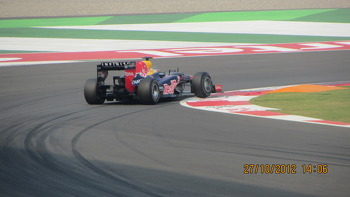 RB8 hitting the apex of Turn 1