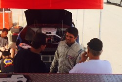 Michael confers with his father Bill Shawhan and JSR Team Manager John Krebs